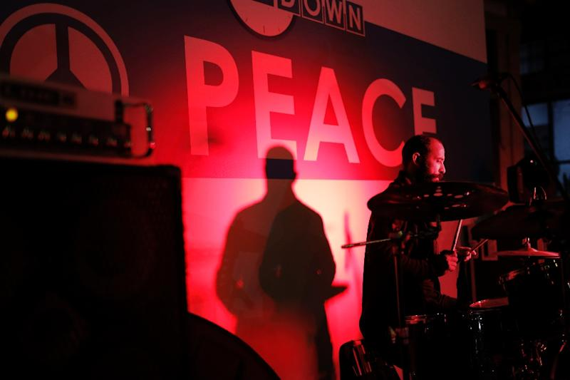"""Musicians from both sides of the Cypriot divide performed during the """"Countdown to Peace"""" event on the eve of UN-sponsored reunification talks (AFP Photo/Florian CHOBLET)"""