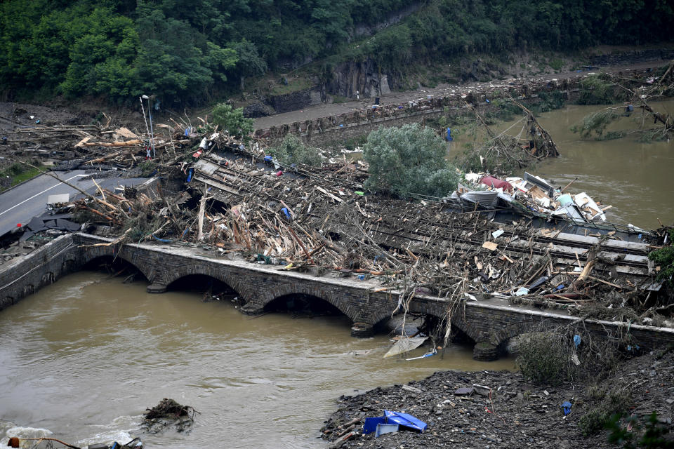 Two bridges at the river Ahr are blocked by rubble in Altenahr, western Germany, Saturday, July 17, 2021. Heavy rains caused mudslides and flooding in the western part of Germany. Multiple have died and are missing as severe flooding in Germany and Belgium turned streams and streets into raging, debris-filled torrents that swept away cars and toppled houses. (Lino Mirgeler/dpa via AP)