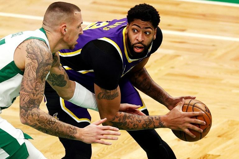 Los Angeles Lakers star Anthony Davis drives against Boston's Daniel Theis in the Lakers' 96-95 NBA victory over the Celtics