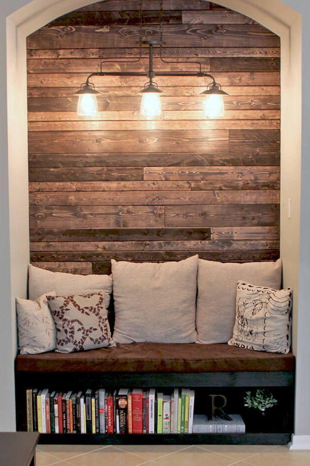 <p>From a custom wooden bench, featuring a bottom shelf to store a small book collection, to a charming wood paneled wall, this library setup proves that going the rustic route can pay off. </p>