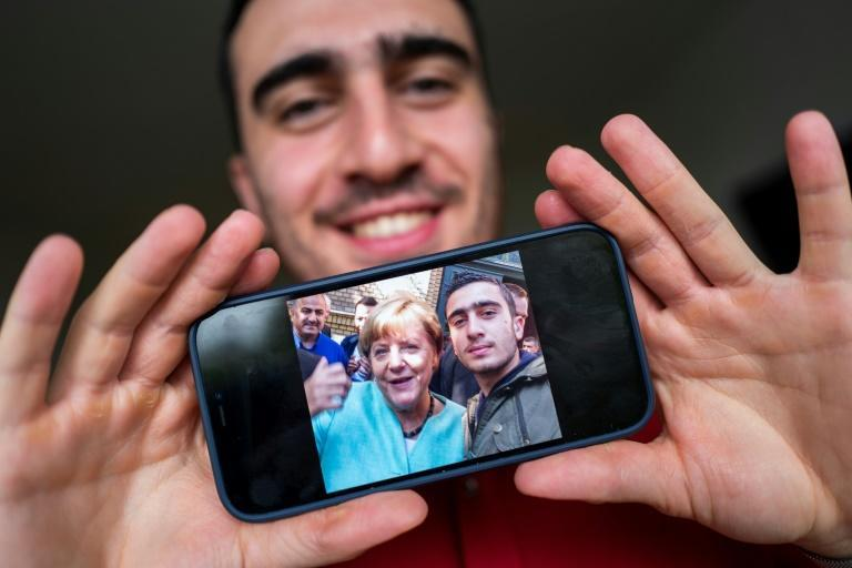 The selfie of Syrian refugee Anas Modamani with German Chancellor Angela Merkel at the height of Europe's migrant crisis in 2015 become a symbol of her generous migration policy (AFP/John MACDOUGALL)