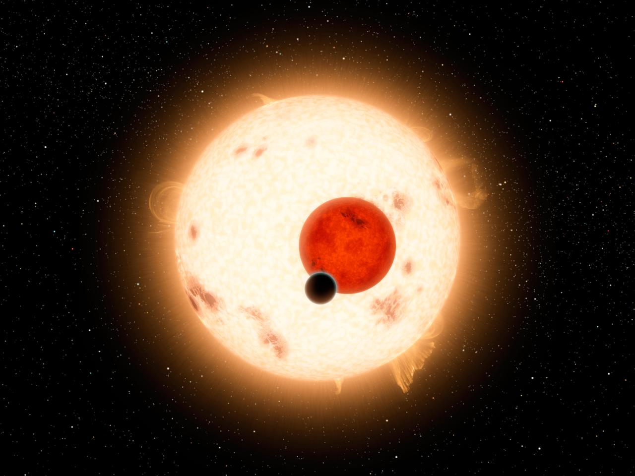 NASA handout image shows an artist's concept of the planet Kepler-16b with its two stars. The cold planet, with its gaseous surface, is not thought to be habitable. The largest of the two stars, a K dwarf, is about 69 percent the mass of our sun, and the smallest, a red dwarf, is about 20 percent the sun's mass. These star pairs are called eclipsing binaries. REUTERS/NASA/JPL-Caltech/R. Hurt/Handout