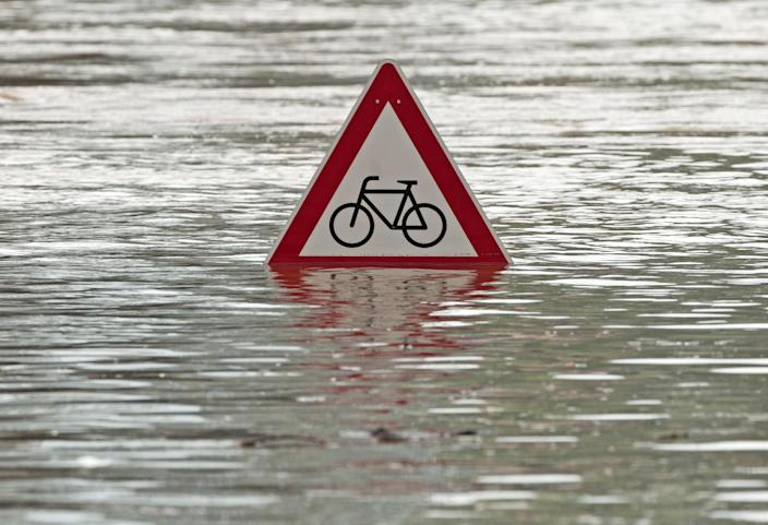 A traffic sign flooded by river Elbe stands in the water in Dresden, eastern Germany, Thursday, June 6, 2013. Heavy rainfalls cause flooding along rivers and lakes in Germany, Austria, Switzerland and the Czech Republic. (AP Photo/Jens Meyer)