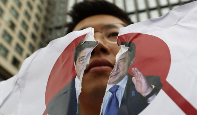 China is attempting to bring Japan and South Korea together when relations between the neighbours are at a low point. Photo AP