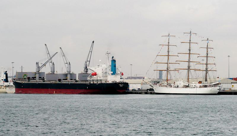 The flagship of Argentina's navy, the A.R.A. Libertad, right, sits docked at the port of Tema, outside Accra, Ghana, where it is being held by a judge answering a complaint from a U.S. hedge fund, Friday, Oct. 5, 2012. A court in Ghana on Tuesday, Oct. 2,  ordered the ship held in port until Argentina posts a court bond equal to its value, which could be $10 million or more. The three-masted tall ship stopped in Tema while training hundreds of navy cadets. (AP Photo/ Christian Thompson)