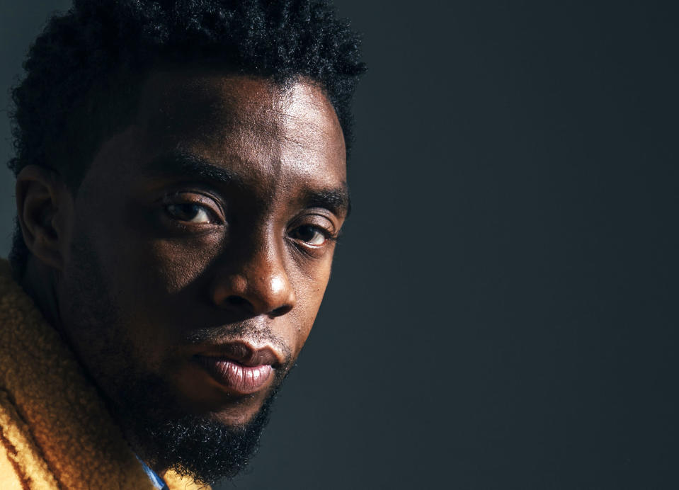 """FILE - In this Feb. 14, 2018, file photo, actor Chadwick Boseman poses for a portrait in New York to promote his film, """"Black Panther."""" The acclaimed actor is being posthumously honored as the namesake of Howard's newly re-established Chadwick A. Boseman College of Fine Arts. Boseman, who graduated in 2000 with a BFA in directing, died in August 2020 at age 43 of colon cancer, after an illness that was largely kept secret. He rose to prominence playing a succession of Black icons in biographical films: Jackie Robinson, singer James Brown and Thurgood Marshall. (Photo by Victoria Will/Invision/AP)"""
