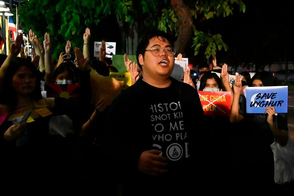 """sings during a Milk Tea Alliance protest outside the Chinese embassy in Bangkok on Oct. 1, 2020.<span class=""""copyright"""">Romeo GACAD—AFP/Getty Images Bunkueanun """"Francis"""" Paothong</span>"""