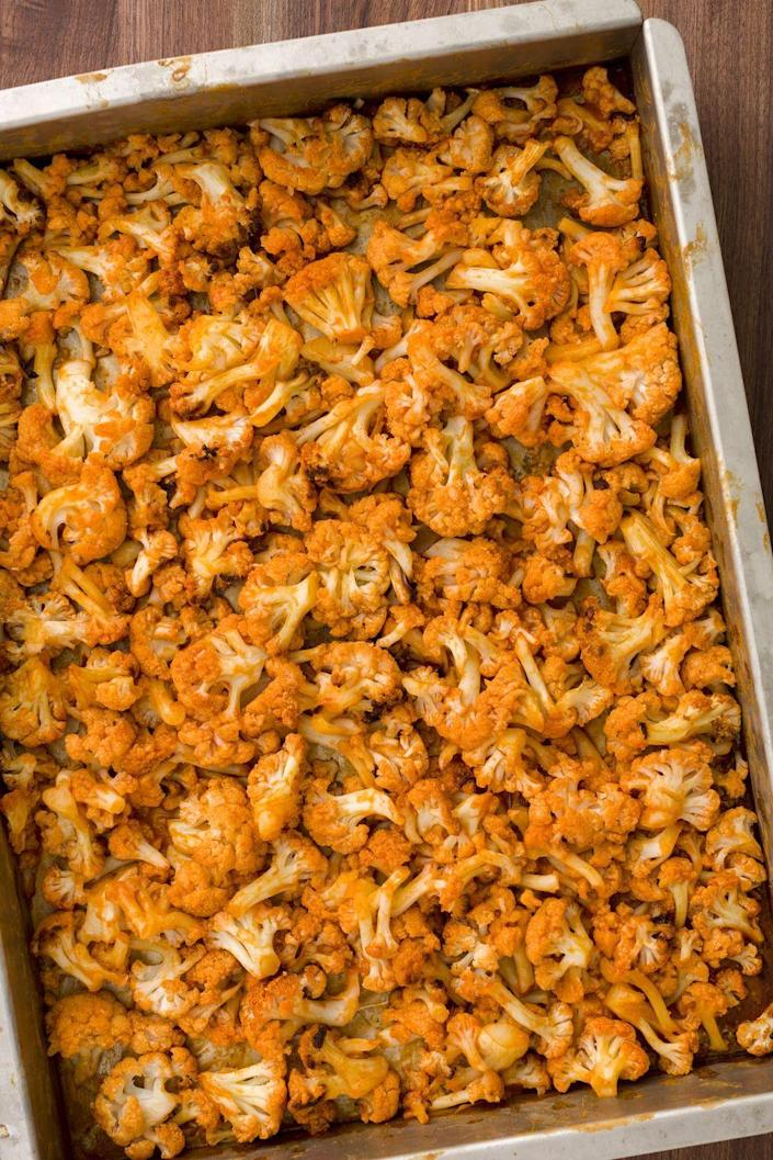 """<p>Healthy crack, in the form of cauliflower.</p><p>Get the recipe from <a href=""""https://www.delish.com/cooking/recipe-ideas/recipes/a45366/buffalo-roasted-cauliflower-recipe/"""" rel=""""nofollow noopener"""" target=""""_blank"""" data-ylk=""""slk:Delish"""" class=""""link rapid-noclick-resp"""">Delish</a>.</p>"""