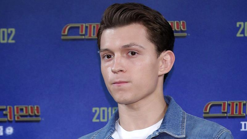Tom Holland Responds After He's Spotted Showing PDA With Mystery Blonde