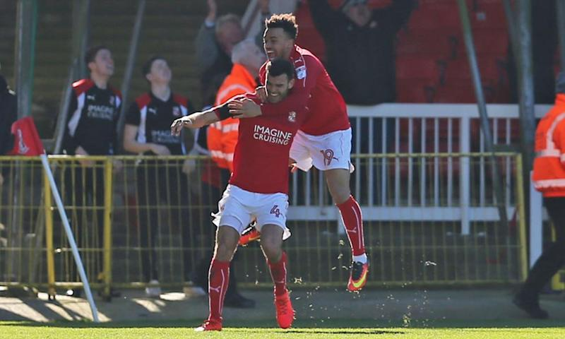 Swindon's Conor Thomas celebrates his last minute goal against Millwall.