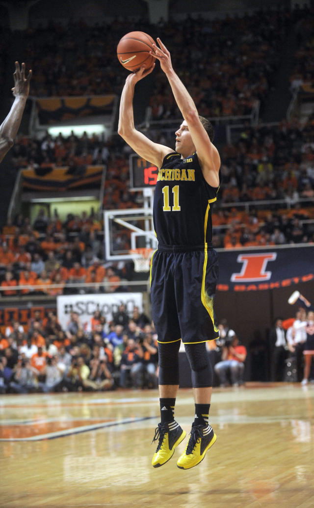 Michigan guard Nik Stauskas goes up with a 3-point shot in the second half in an NCAA college basketball game against Illinois on Tuesday, March 4, 2014, in Champaign, Ill. Michigan won 84-53. (AP Photo/Rick Danzl)