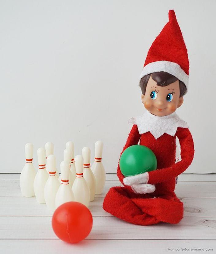 """<p>The best part of this miniature bowling game? Your kids don't just to observe—they can play along!</p><p><strong>Get the tutorial at <a href=""""https://www.artsyfartsymama.com/2019/11/5-creative-elf-on-shelf-ideas.html"""" rel=""""nofollow noopener"""" target=""""_blank"""" data-ylk=""""slk:Artsy Fartsy Mama"""" class=""""link rapid-noclick-resp"""">Artsy Fartsy Mama</a>.</strong> </p>"""