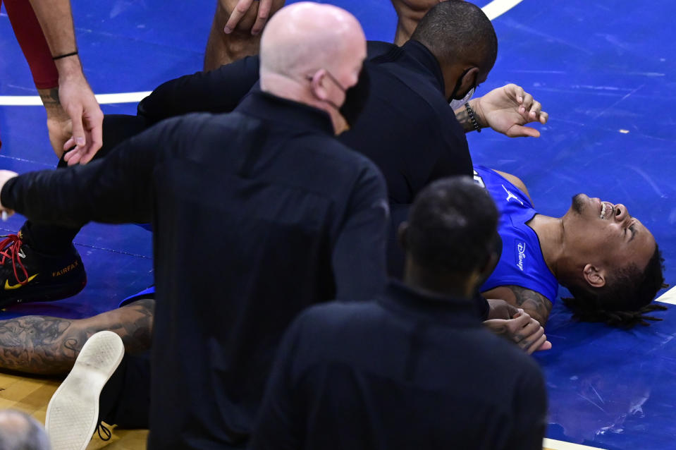 Markelle Fultz lays on the floor clearly in pain and is attended to by team personnel.