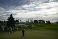 Shane Lowry, of Ireland, putts on the third green in the second round at the Northern Trust golf tournament, Friday, Aug. 20, 2021, at Liberty National Golf Course in Jersey City, N.J. (AP Photo/John Minchillo)