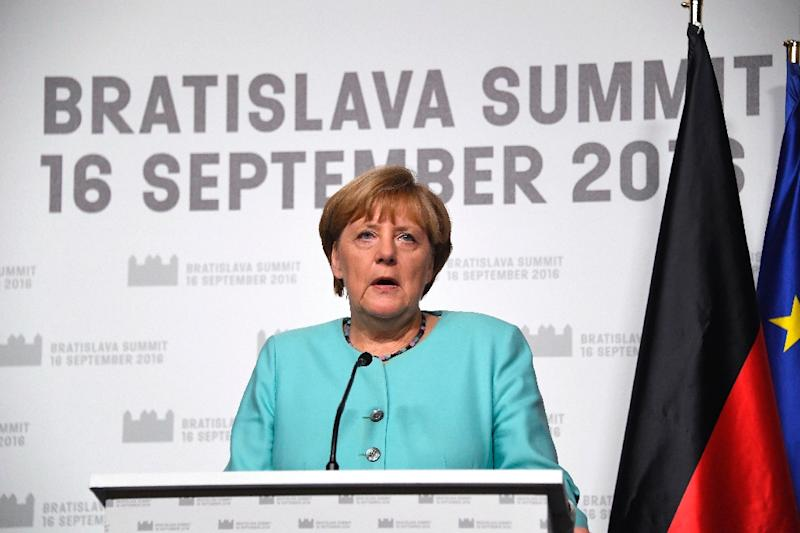 German Chancellor Angela Merkel delivers a joint statement with the French President after the European Union Summit of 27 Heads of State or Government in Bratislava, Slovakia on September 16, 2016