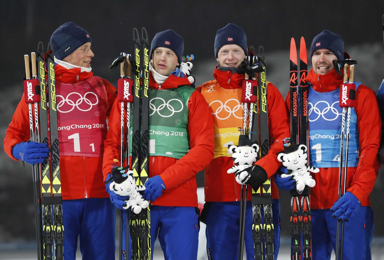Biathlon - Pyeongchang 2018 Winter Olympics - Men's 4x7.5 km Relay Final - Alpensia Biathlon Centre - Pyeongchang, South Korea - February 23, 2018 - Silver medalists Lars Helge Birkeland, Tarjei Boe, Johannes Thingnes Boe and Emil Hegle Svendsen of Norway pose during the victory ceremony. REUTERS/Murad Sezer