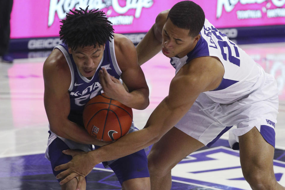 Kansas State guard Nijel Pack (24) tries to hold on to a rebound next to TCU forward Jaedon LeDee (23) during an NCAA college basketball game Saturday, Feb. 20, 2021, in Fort Worth, Texas. (AP Photo/Richard W. Rodriguez)
