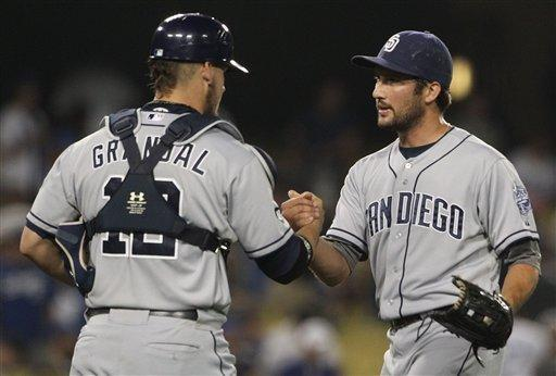 San Diego Padres reliever Huston Street and catcher Yasmani Grandal celebrate their 7-6 win over the Los Angeles Dodgers in a baseball game in Los Angeles, Saturday, July 14, 2012. (AP Photo/Reed Saxon)
