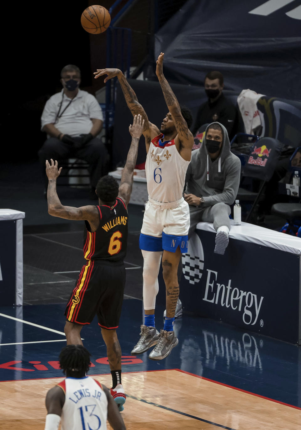 New Orleans Pelicans guard Nickeil Alexander-Walker (6) shoots over Atlanta Hawks guard Lou Williams (6) in the first quarter of an NBA basketball game in New Orleans, Friday, April 2, 2021. (AP Photo/Derick Hingle)