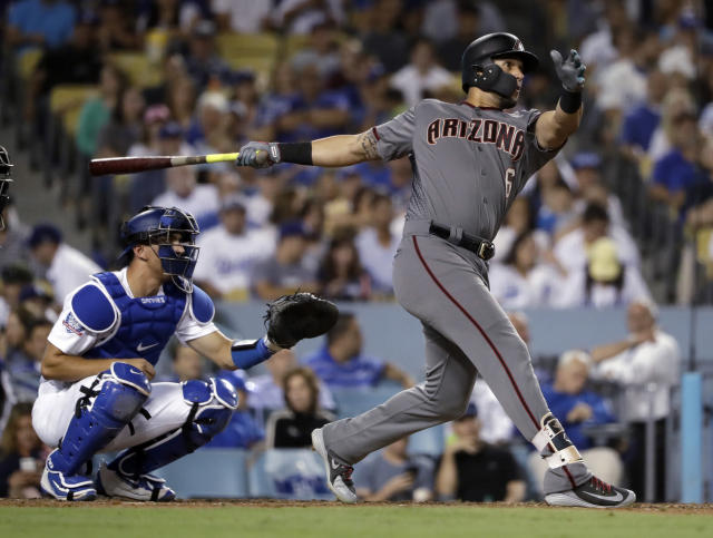 Arizona Diamondbacks' David Peralta follows through on a three-run home run against the Los Angeles Dodgers during the fifth inning of a baseball game Thursday, Aug. 30, 2018, in Los Angeles. (AP)