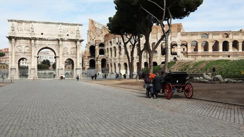 The square in front of the Colosseum, which is usually crowded with hundreds of tourist stands almost empty