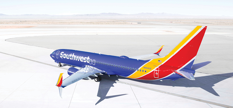 Southwest airplane on taxiway at an airport in a desert environment.