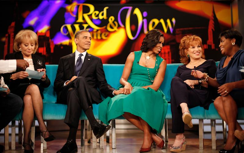 """President Barack Obama and first lady Michelle Obama appear on the ABC Television show """"The View"""" in New York, Monday, Sept. 24, 2012, From left are, Barbara Walters, president and first lady, Joy Behar, and Sherri Shepherd. (AP Photo/Pablo Martinez Monsivais)"""