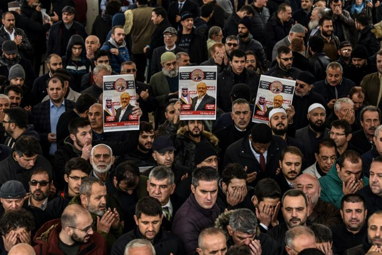 People hold banners of Jamal Khashoggi during a symbolic funeral prayer for the Saudi journalist, in Istanbul