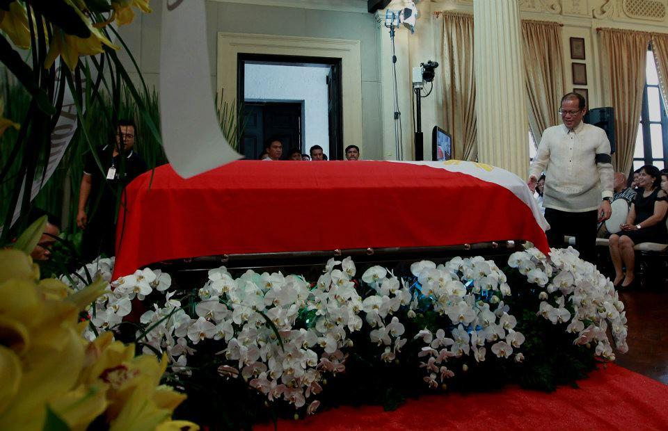 President Benigno S. Aquino III evens the Philippine flag draping the casket of the late Interior and Local Government Secretary Jesse Robredo during the memorial service at the Kalayaan Hall, Malacañan Palace on Friday (August 24). His remains will lie in state in Malacañang until Sunday morning (August 26). President Aquino signed Proclamation No. 460, declaring National Days of Mourning starting August 21 to mark the death of the former DILG Chief until his interment. The national flag will be flown at half-mast from sunrise to sunset in all government buildings in the Philippines and in the country's posts abroad for a period of six days. (Photo by Jay Morales, Malacañang Photo Bureau, NPPA)