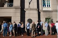 <p>Reporters and spectators line up outside the Albert V. Bryan US Courthouse, where the bank fraud trial of former Trump campaign manager Paul Manafort is taking place, to watch scheduled closing arguments in Alexandria, Va., Aug. 15, 2018. (Photo: Saul Loeb/AFP/Getty Images) </p>