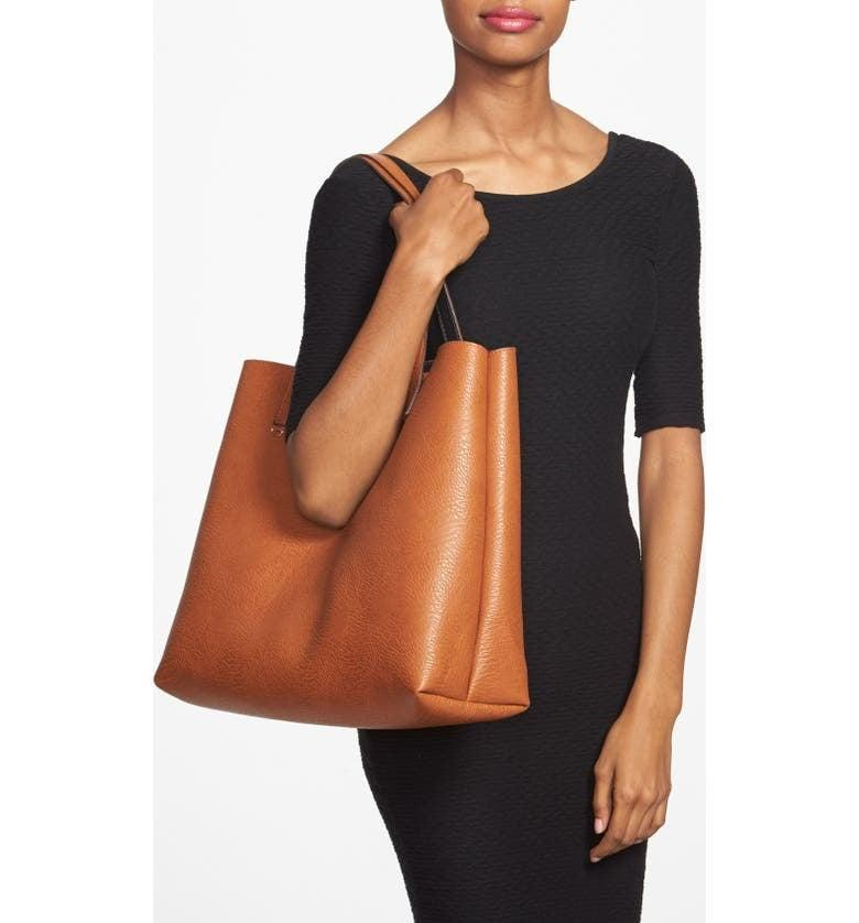 <p>This versatile <span>Street Level Reversible Faux Leather Tote &amp; Wristlet</span> ($49) can be worn two different ways.</p>