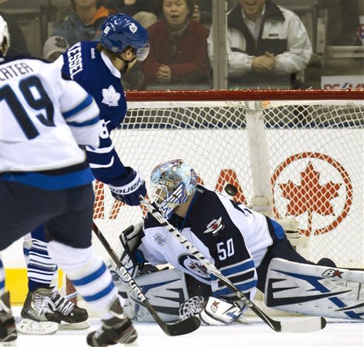 Toronto Maple Leafs' Phil Kessel (81) scores on Winnipeg Jets goaltender Chris Mason (50) during the first period of an NHL hockey game, Thursday, Jan. 5, 2012, in Toronto. (AP Photo/The Canadian Press, Frank Gunn)