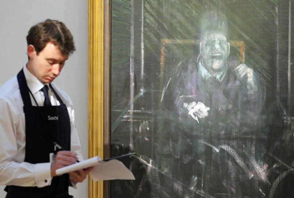 A Sotheby's employee stands in front of Francis Bacon's 'Untitled (Pope)' painting at the auction house's London office.