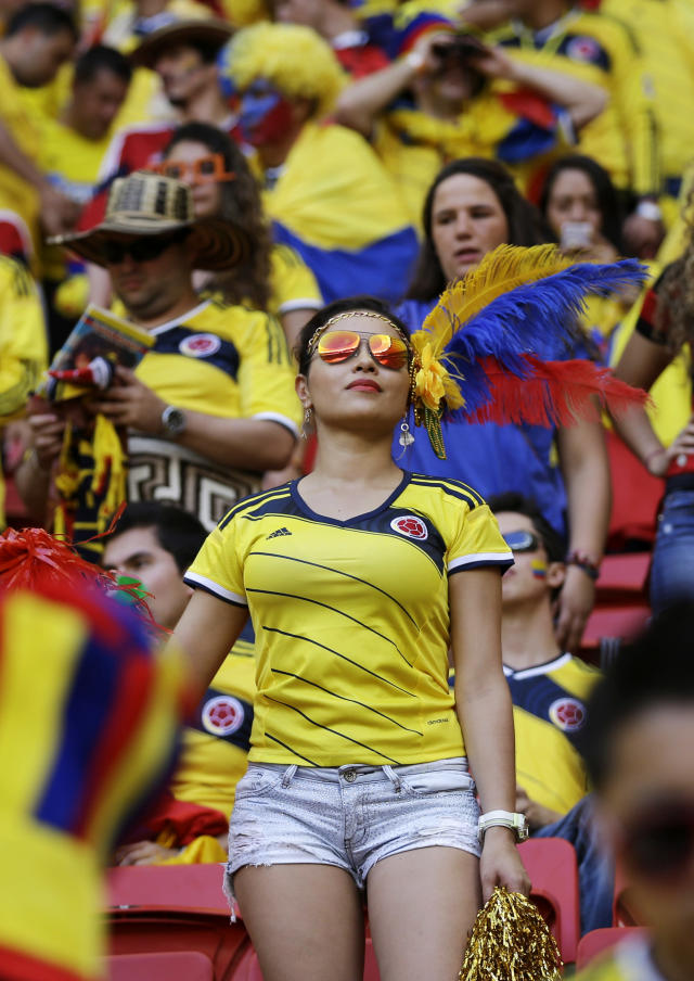 Spectators wait for the start of the group C World Cup soccer match between Colombia and Ivory Coast at the Estadio Nacional in Brasilia, Brazil, Thursday, June 19, 2014. (AP Photo/Martin Mejia)