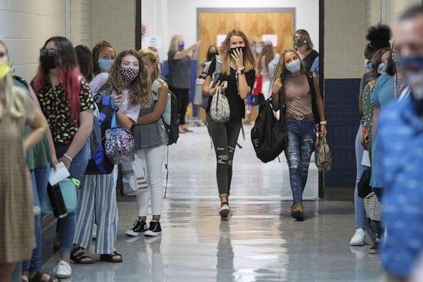 PHOTO: Guntown Middle School eighth grade girls walk the halls first to their next class before the boys are dismissed during a class change on the first day back to school for the Lee County District, in Guntown, Mississippi, on Aug. 6, 2020. (Adam Robison/The Northeast Mississippi Daily Journal via AP)