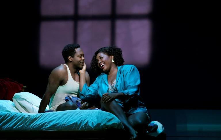 """Actors Angel Blue (R) and Will Liverman perform a scene during a rehearsal for Terence Blanchard's """"Fire Shut Up in My Bones,"""" the first opera staged by a Black composer at the Metropolitan Opera (AFP/TIMOTHY A. CLARY)"""