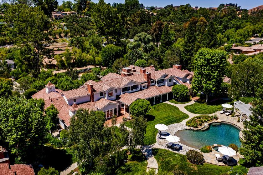 HIGH $27.5 million The 2.6-acre spread includes two homes that combines for 21,000 square feet, a backyard with a pool and horse facilities, and a sports facility with a gym, racquetball court, batting cage, tanning room and 150-person party room.