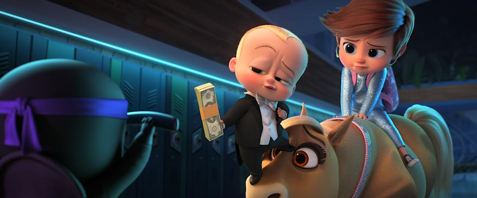 (from left) The Boss Baby/Ted Templeton (Alec Baldwin) and young Tim Templeton (James Marsden) in DreamWorks Animation's The Boss Baby: Family Business, directed by Tom McGrath.