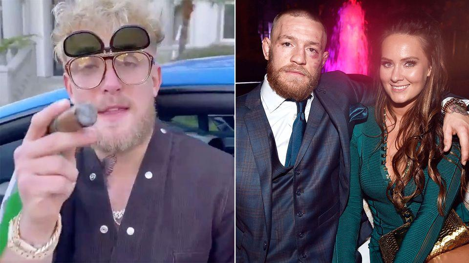 Seen here, Youtuber Jake Paul next to a photo of Conor McGregor with wife Dee Devlin.