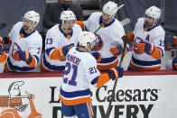 New York Islanders' Kyle Palmieri (21) returns to the bench after scoring during the first period in Game 1 of an NHL hockey Stanley Cup first-round playoff series against the Pittsburgh Penguins in Pittsburgh, Sunday, May 16, 2021. (AP Photo/Gene J. Puskar)