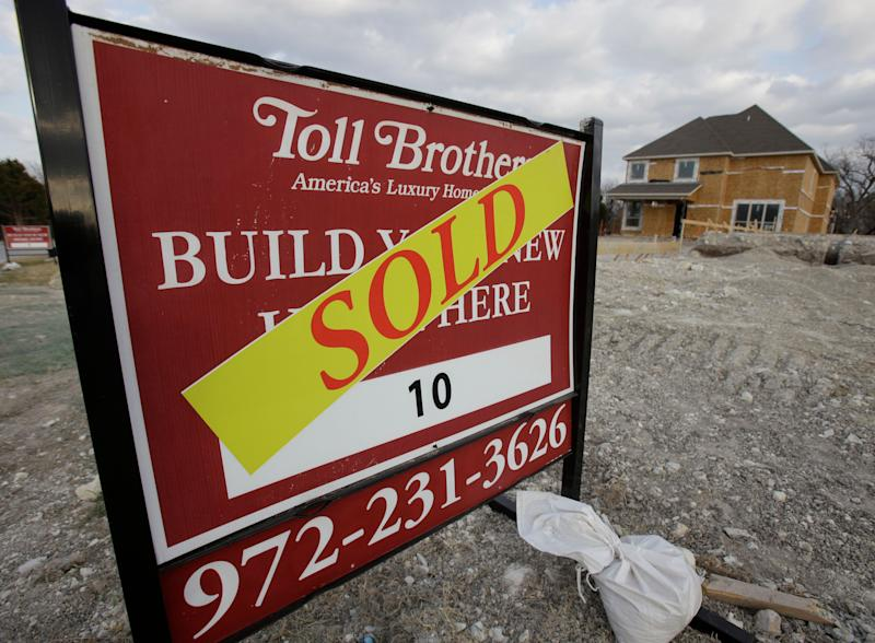 In this Feb. 20, 2011 photo, a sold sign sits in front of home built by Toll Brothers construction in Richardson, Texas. Toll Brothers Inc. posted a surprise first-quarter profit, helped by a larger tax benefit, a higher average delivery price for its homes and more normalized cancellation rates.(AP Photo/LM Otero)