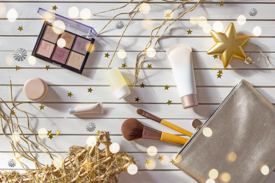 Directly Above Shot Of Beauty Products With Christmas Decorations On Table