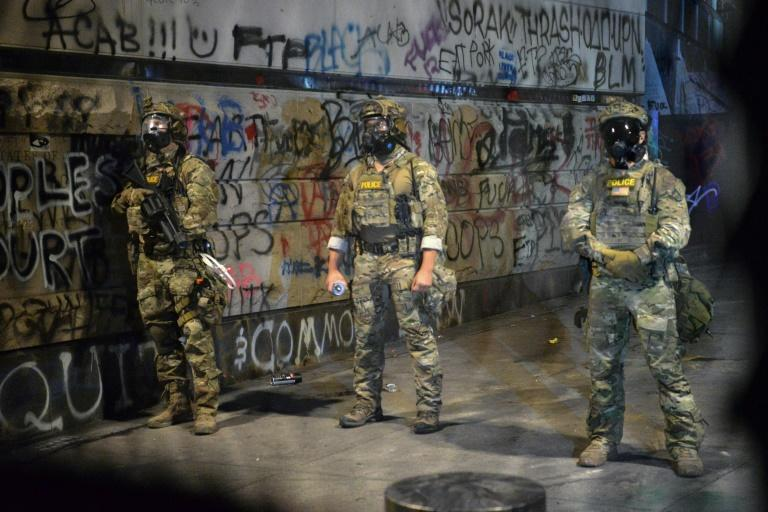 Federal officers are pictured in Portland, Oregon on July 25, 2020 -- the city has been rocked by weeks of clashes between demonstrators and law enforcement