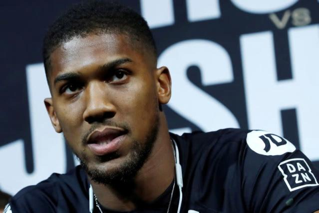 FILE PHOTO: Boxer Anthony Joshua speaks at a news conference ahead of his heavyweight boxing title rematch against Andy Ruiz Jr. in New York