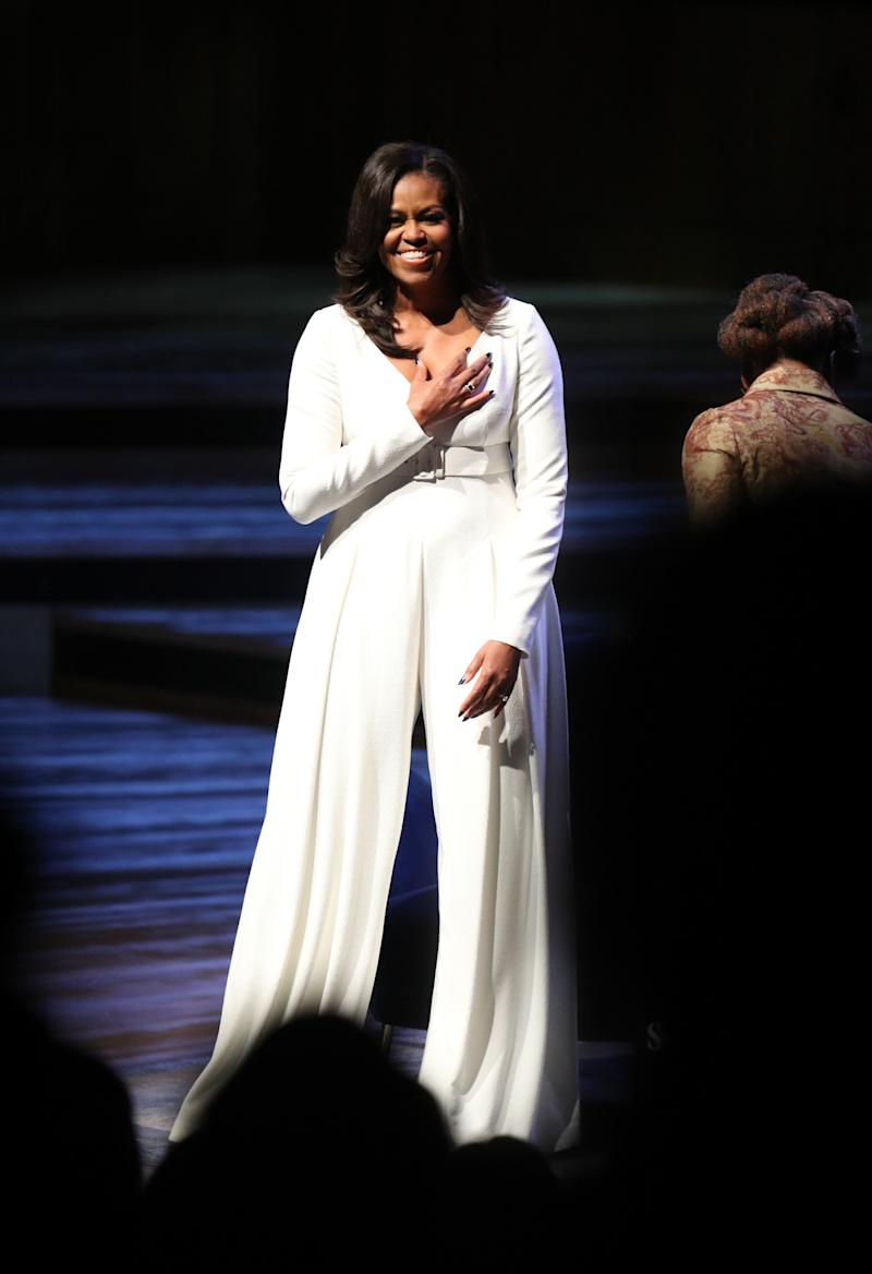Obama acknowledges the crowd at the Royal Festival Hall in London during her visit to the UK to publicize her memoir, which tells of her personal journey to becoming First Lady and her time in the White House.