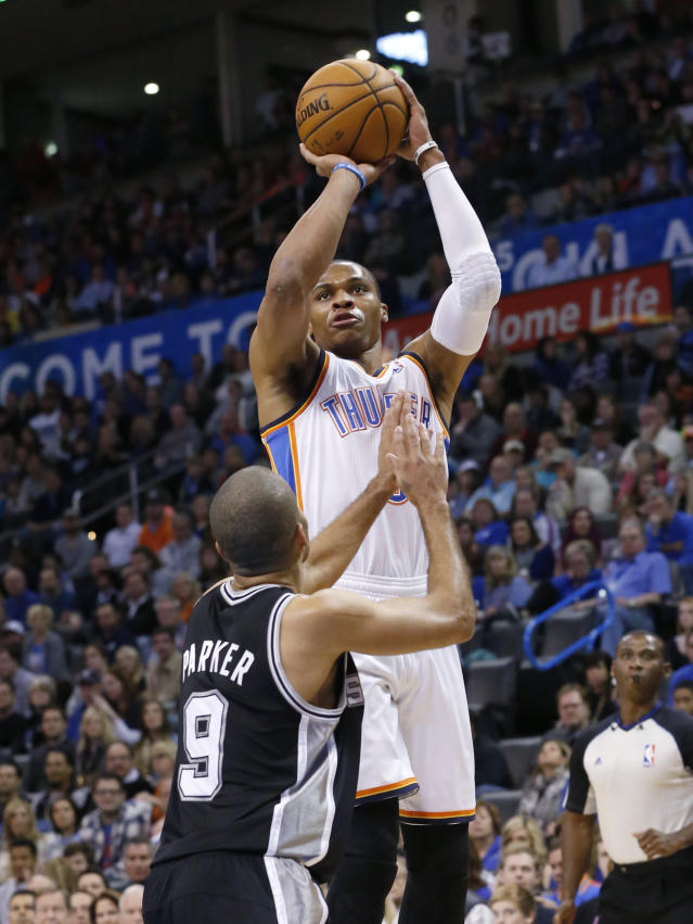 Oklahoma City Thunder guard Russell Westbrook (0) shoots over San Antonio Spurs guard Tony Parker (9) in the first quarter of an NBA basketball game in Oklahoma City, Wednesday, Nov. 27, 2013. (AP Photo/Sue Ogrocki)