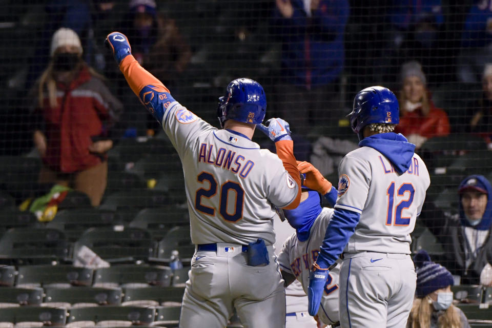 New York Mets first baseman Pete Alonso (20) celebrates his 2-run home run against the Chicago Cubs during the fifth inning of a baseball game Wednesday, April 21, 2021, in Chicago. (AP Photo/Mark Black)