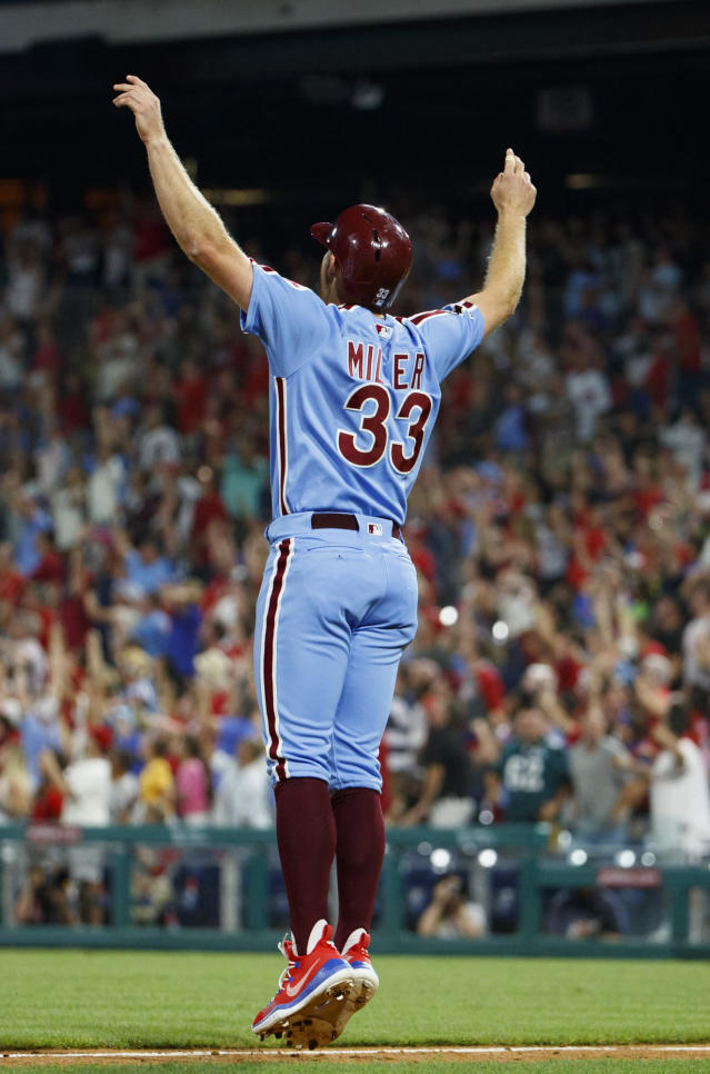Philadelphia Phillies' Brad Miller reacts to the grand slam by Bryce Harper during the ninth inning of the team's baseball game against the Chicago Cubs, Thursday, Aug. 15, 2019, in Philadelphia. The Phillies won 7-5. (AP Photo/Chris Szagola)