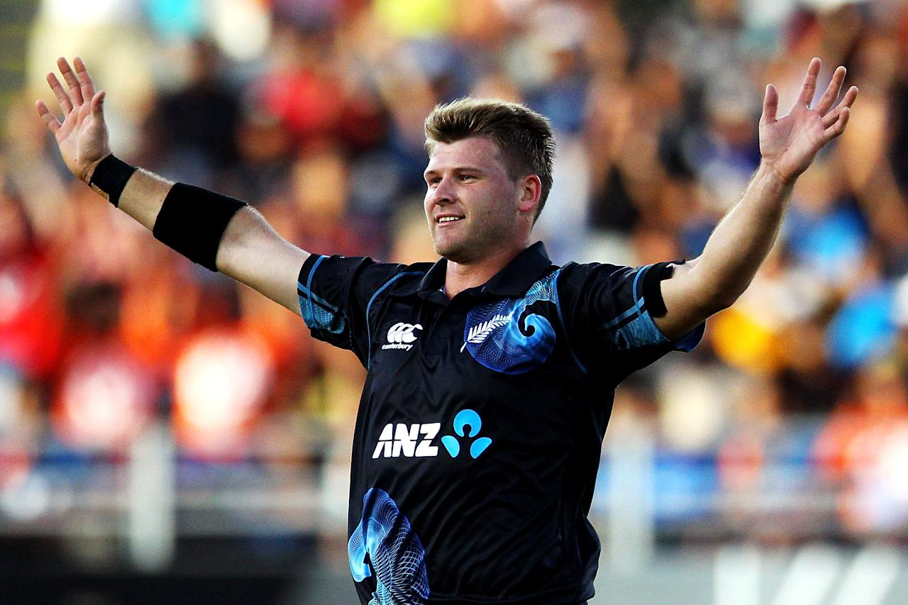 AUCKLAND, NEW ZEALAND - JANUARY 25:  Corey Anderson of New Zealand celebrates after taking the wicket of Ajinkya Rahane of India during the One Day International match between New Zealand and India at Eden Park on January 25, 2014 in Auckland, New Zealand.  (Photo by Anthony Au-Yeung/Getty Images)