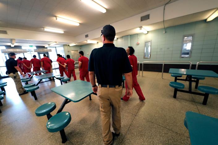 Detainees leave the cafeteria under the watch of guards during a media tour at the Winn Correctional Center in Winnfield, Louisiana, Sept. 26, 2019. (AP Photo/Gerald Herbert) (Photo: ASSOCIATED PRESS)